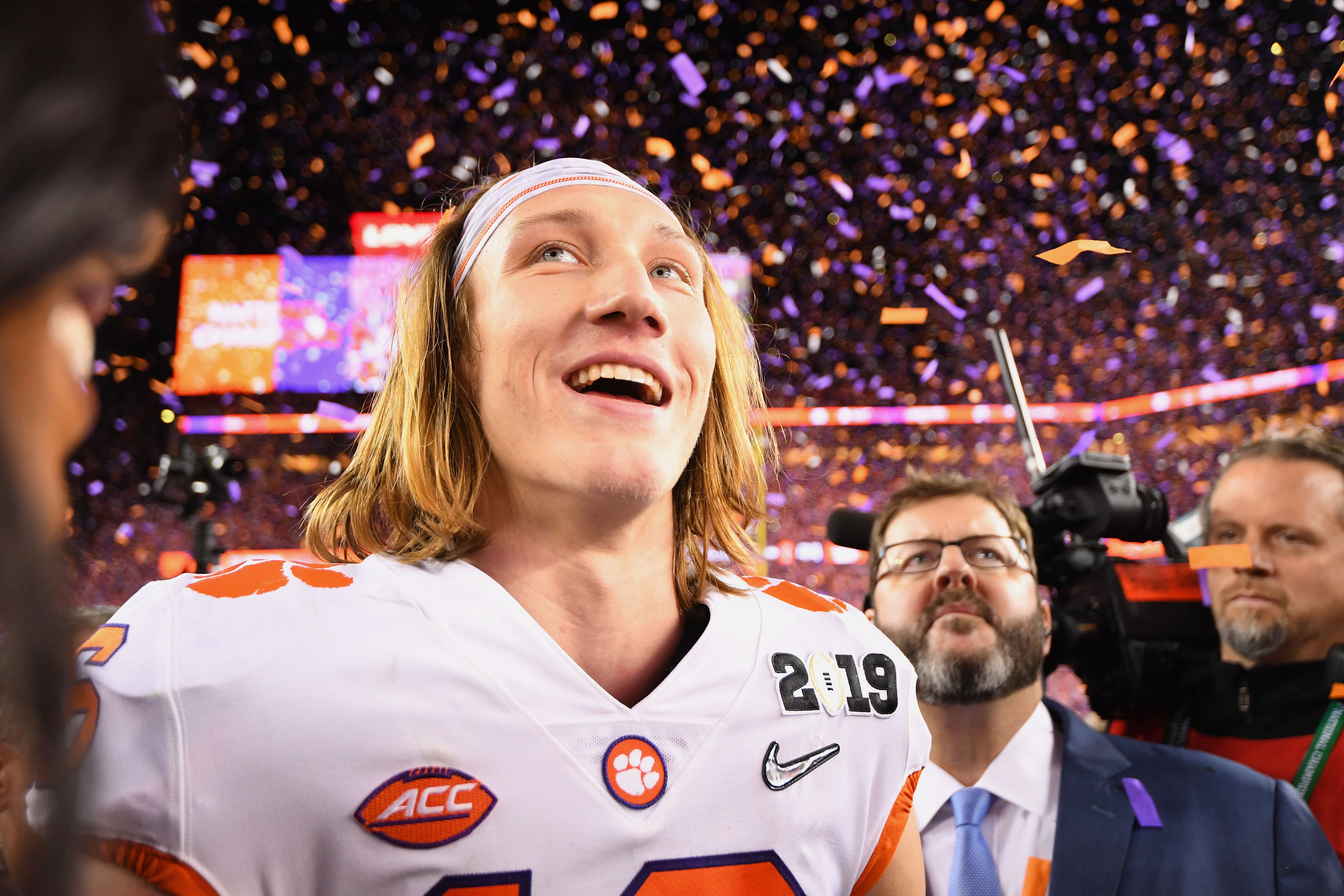 SANTA CLARA, CA - JANUARY 07: Trevor Lawrence #16 of the Clemson Tigers celebrates after defeating the Alabama Crimson Tide during the College Football Playoff National Championship held at Levi's Stadium on January 7, 2019 in Santa Clara, California. Clemson defeated Alabama 44-16. (Photo by Jamie Schwaberow/Getty Images)