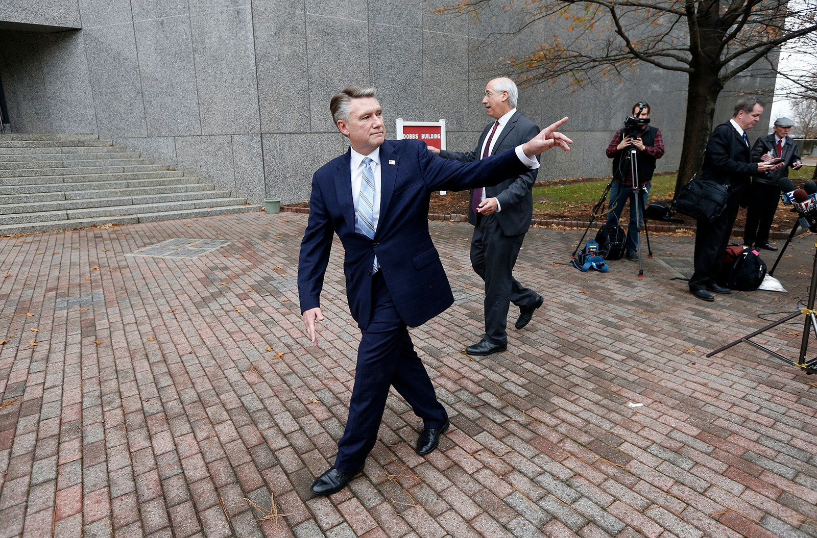 Republican Mark Harris, left, and his attorney David Freedman leave after speaking with the media following a meeting with state election investigators on Thursday, Jan. 3, 2019 at the Dobbs Building in Raleigh, N.C. (Ethan Hyman/Raleigh News & Observer/TNS via Getty Images)