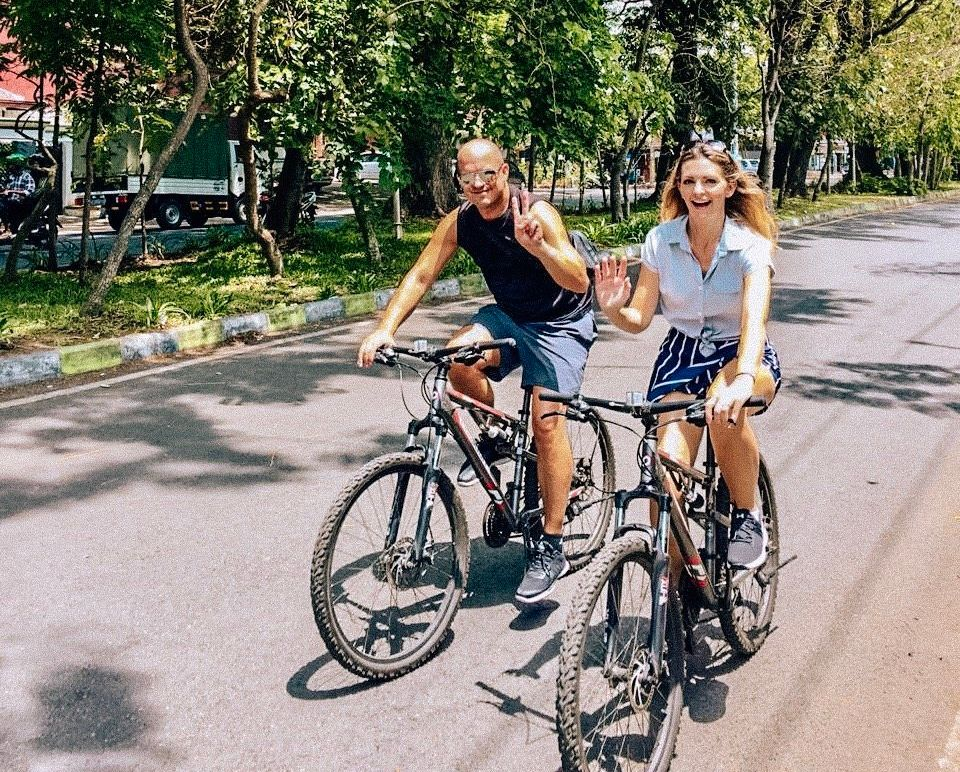 Kashlee and her husband, Trevor, biking through Malang, Indonesia, in