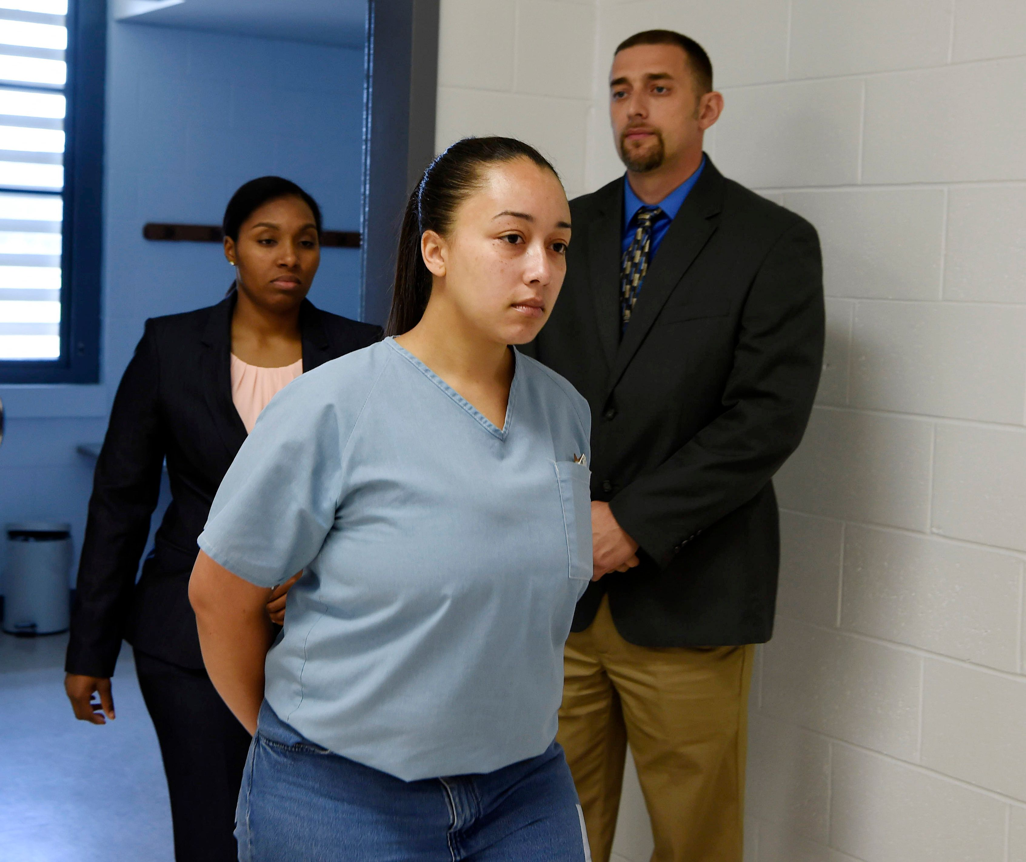 Cyntoia Brown, a woman serving a life sentence for killing a man when she was a 16-year-old prostitute, enters her clemency hearing Wednesday, May 23, 2018, at Tennessee Prison for Women in Nashville, Tenn. (Lacy Atkins /The Tennessean via AP, Pool)