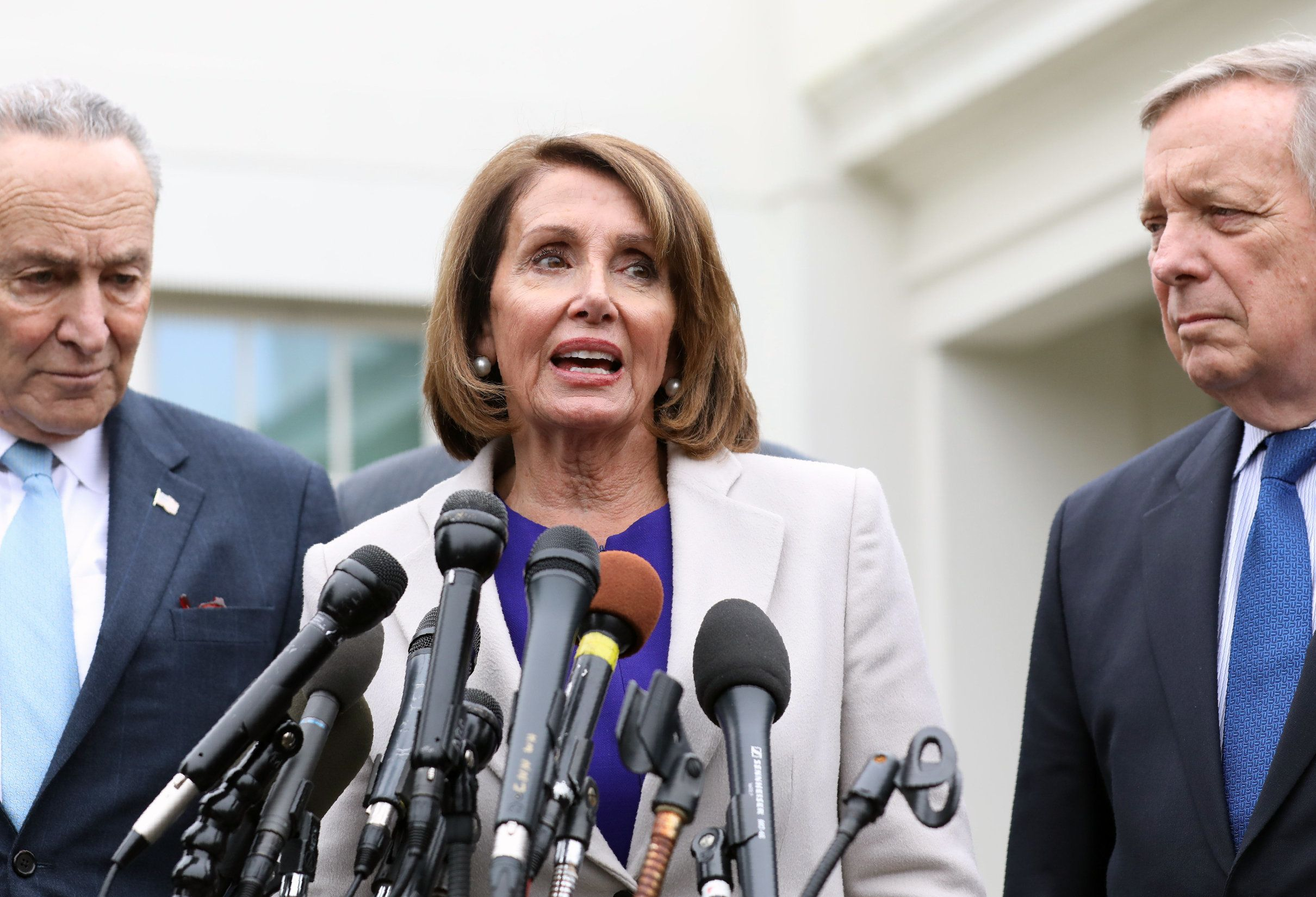 House Speaker Nancy Pelosi (C), D-CA, Senate Minority Leader Chuck Schumer (L), D-NY, and Senator Dick Durbin (R), D-IL, speak to the media outside the White House after meeting with US President Donald Trump to discuss the partial government shutdown, January 4, 2019 in Washigton, DC. (Photo by Alex Edelman / AFP)        (Photo credit should read ALEX EDELMAN/AFP/Getty Images)