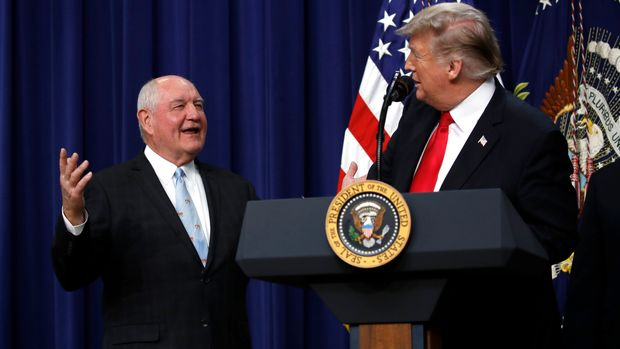 "President Donald Trump listens to Agriculture Secretary Sonny Perdue during a signing ceremony for H.R. 2, the ""Agriculture Improvement Act of 2018,"" in the South Court Auditorium of the Eisenhower Executive Office Building, on the White House complex, Thursday, Dec. 20, 2018, in Washington. (AP Photo/Jacquelyn Martin)"