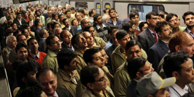 Indian metro workers listen to an announcement during the flag off for the trial run of the first section...