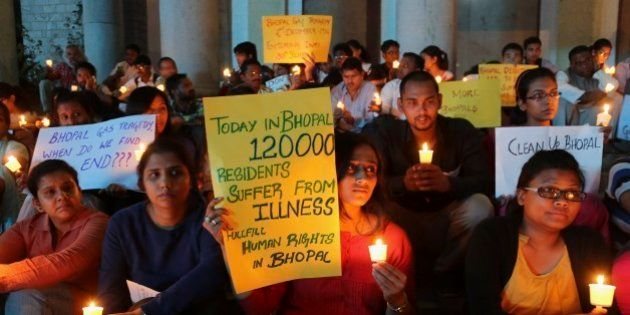 Members of student groups and activists of social organizations participate in a candle light vigil to...