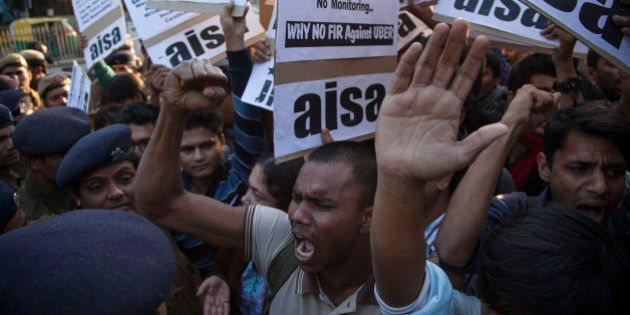 Protestors from All India Students Association (AISA) demonstrate outside the Delhi Police headquarters...