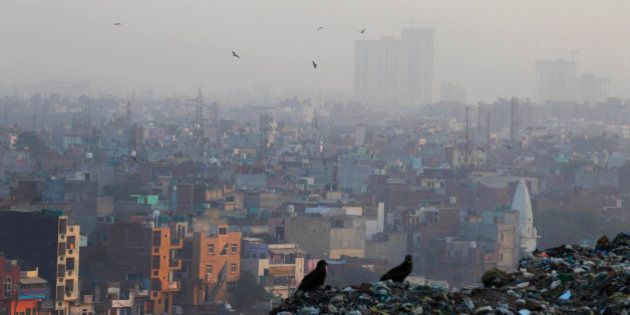 A blanket of dust and smoke covers the city landscape in in New Delhi, India, Friday, Oct. 17, 2014....