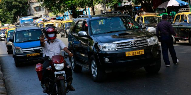 In this photo taken on April 3, 2014, Uber driver Dinish Karamsesula, right, whose employer partnered...