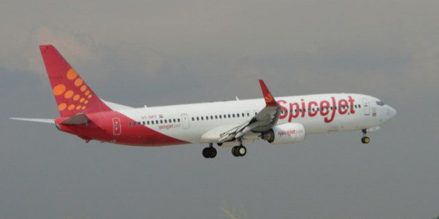An aircraft of Indian airline Spicejet lands at Indira Gandhi International Airport in New Delhi on September...