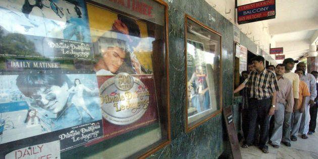 BOMBAY, INDIA: Moviegoers que up to the ticket window at the city's prestigious Maratha Mandir movie...