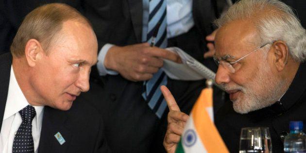 Russia's President Vladimir Putin, left, and India's Prime Minister Narendra Modi chat during the BRICS...