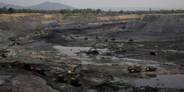 This April 15, 2014 photo, shows mining in progress at an open coat pit that belongs to Jindal Steel...