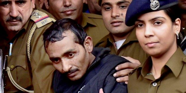 32-year-old Shiv Kumar Yadav, center, a driver from the international taxi-booking service Uber, is surrounded...