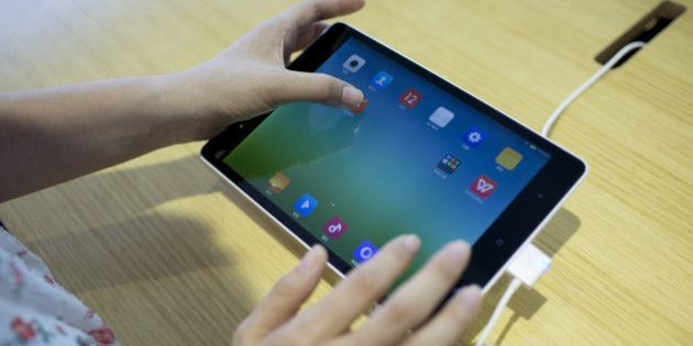 A Xiaomi Corp. Mi Pad tablet is arranged for a photograph at the company's showroom in Beijing, China,...