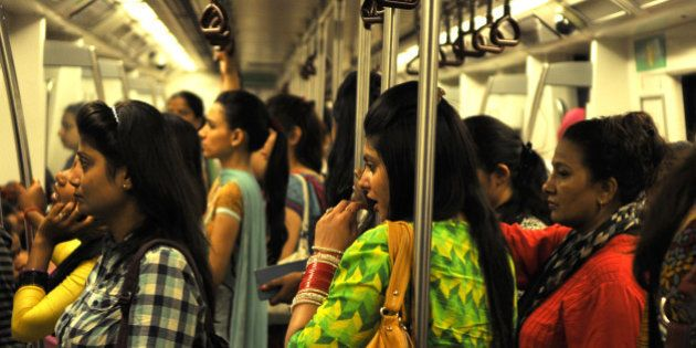NEW DELHI, INDIA - JUNE 26: Indian women travel inside a Women Only metro train compartment after the...