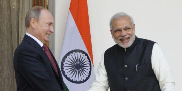NEW DELHI, INDIA - DECEMBER 11: Indian Prime Minister Narendra Modi (R) and Russian President Vladimir...