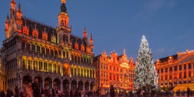 A giant Christmas tree and a light show decorate the Grand Place in Brussels, Wednesday, Dec. 12, 2014....