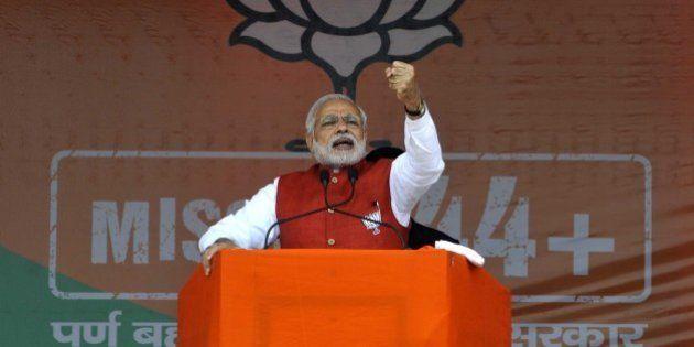 JAMMU, INDIA - DECEMBER 13: Prime Minister Narendra Modi addressing during an election rally at Kathua,...