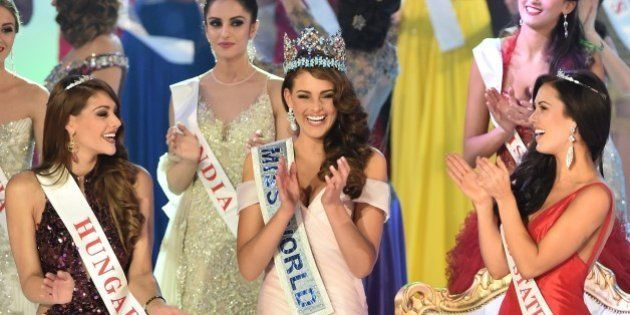 Miss South Africa and the 2014 Miss World, Rolene Strauss (C), dances with first runner up Miss Hungary...