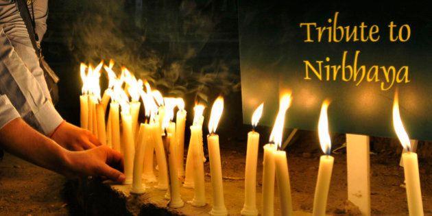 NEW DELHI, INDIA - DECEMBER 16: Indian students take part in a candle-light vigil at Jantar Mantar mark...