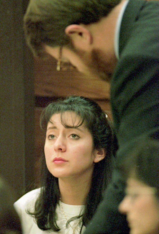 MANASSAS, UNITED STATES:  As her attorney James Lowe studies documents, Lorena Bobbitt (L) listens to testimony on the third day of her malicious wounding trial in Manassa, VA, 12 January 1994. If found guilty, the Ecuadoran-born manicurist faces up to 20 years in prison and could be deported. (Photo credit should read POOL/AFP/Getty Images)