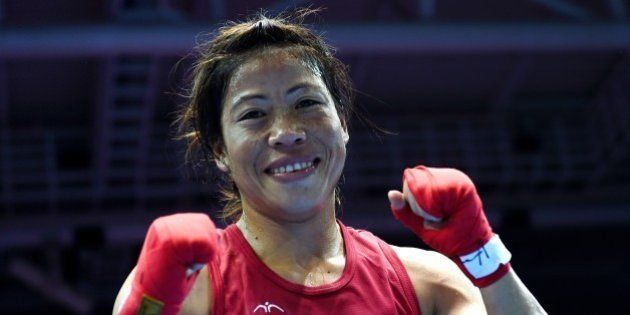 Gold medallist India's Hmangte Chungneijang Mary Kom reacts after being declared the winner of the women's...