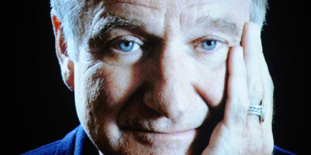 Robin Williams seen on screen during an In Memoriam tribute at the 66th Primetime Emmy Awards at the...