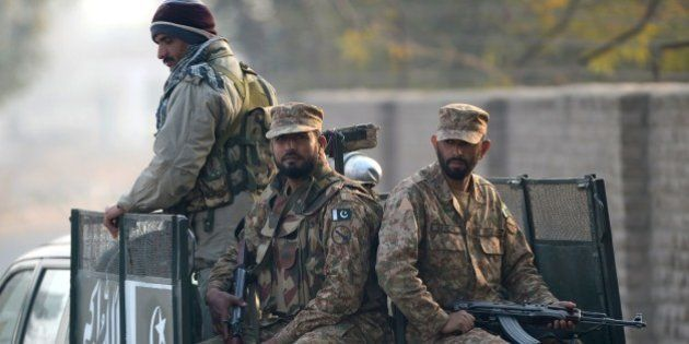 Pakistani army soldiers patrol in a vehicle in Peshawar on December 17, 2014, the day after an attack...