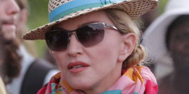 U.S singer Madonna arrives in Kasungu, about 150 kilometers north of the capital Lilongwe, Sunday, Nov....