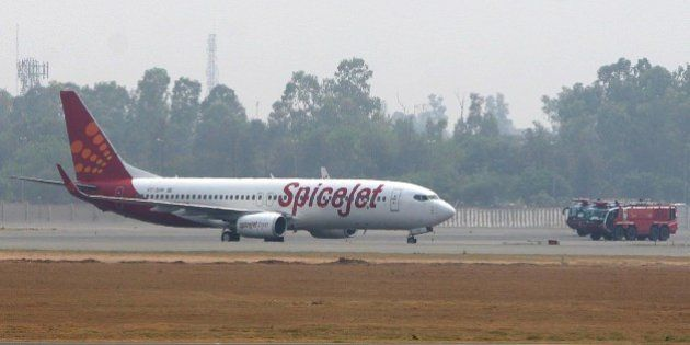 NEW DELHI, INDIA - MAY 24: Fire trucks surround a Spicejet Boeing 737-800 aircraft which made an emergency...