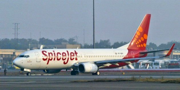 FILE – In this Friday, Jan 26, 2007 file photo, a SpiceJet aircraft taxies on the runway at the airport...