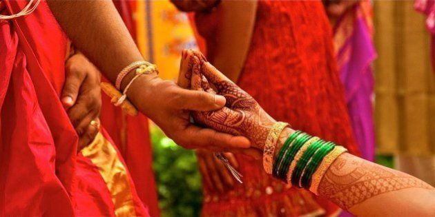 A traditional Indian Wedding, with lots of vibrant colors and fun, holding hands in this style is a part...