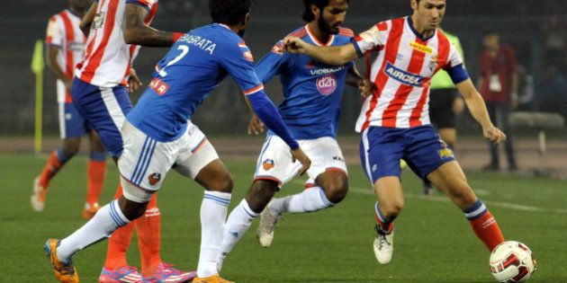 KOLKATA, INDIA - DECEMBER 10: Atletico De Kolkata player Luis Garcia (R) is being challenged by FC Goa...