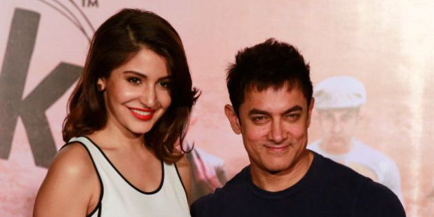 Bollywood actors Aamir Khan, right, and Anushka Sharma pose for photographs during the teaser launch...