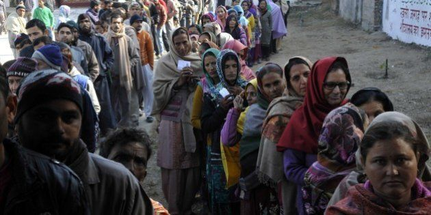 JAMMU, INDIA - DECEMBER 20: Voters standing in a queue to cast their vote at polling station during assembly...