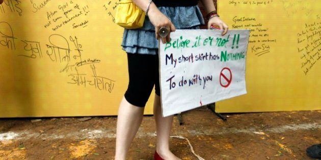 A woman holds a placard as messages written by people are seen in the background at the