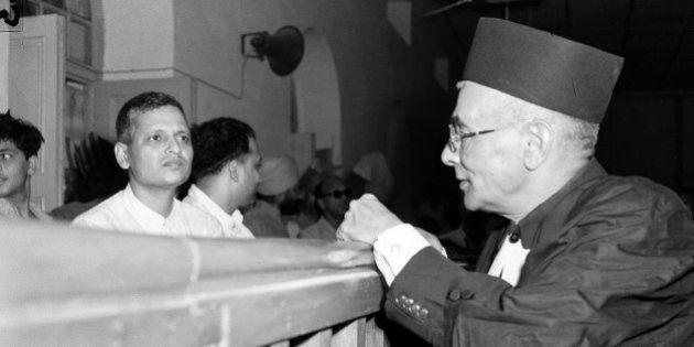 Nathuram Godse, left, one of nine co-defendants in the Mohandas Gandhi assassination conspiracy case,...