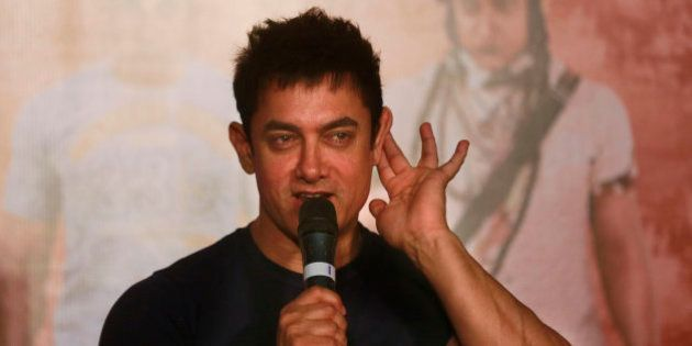 Bollywood actor Aamir Khan gestures as he speaks to the media during the teaser launch of his upcoming