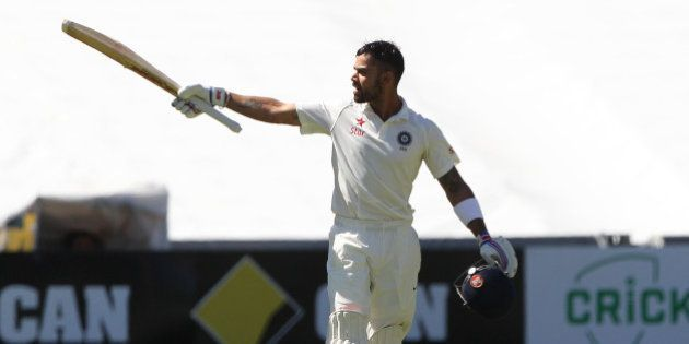 India's Virat Kohli reacts after reaching a century during the final day of their cricket test match...