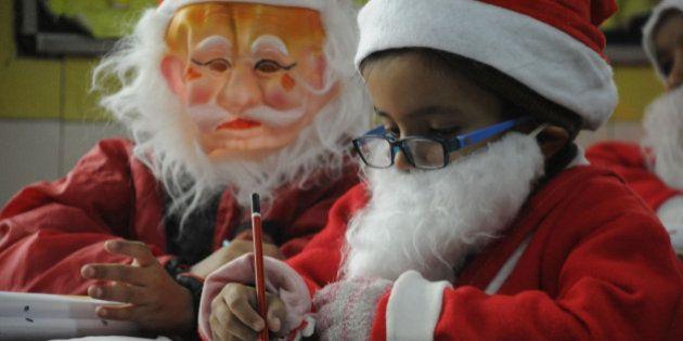 GURGAON, INDIA DECEMBER 24: Children attending their classes dressed as Santa Claus dress at Euro International...