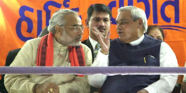 Indian Prime Minister Atal Bihari Vajpayee, right, shares a joke with Gujarat's chief Minister Narendra...