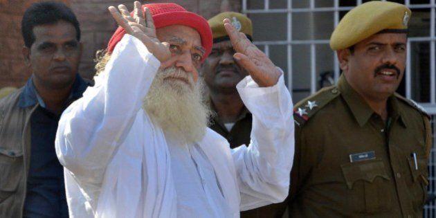 JODHPUR, INDIA - NOVEMBER 18: Asaram Bapu, Hindu preacher gestures to media persons as he returns after...
