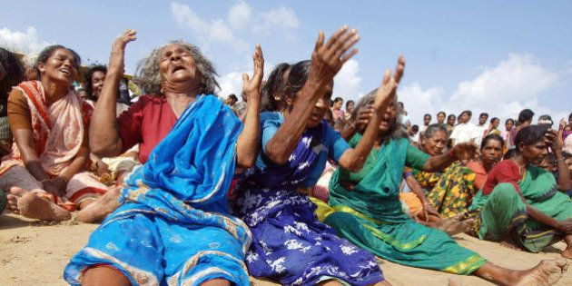 NAGAPATTINAM, INDIA: Indian survivors of the December 2004 tsunami burst into tears after they performed...