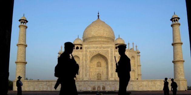Indian paramilitary soldiers stand guard in front of the Taj Mahal in Agra, India, Wednesday, April 17,...