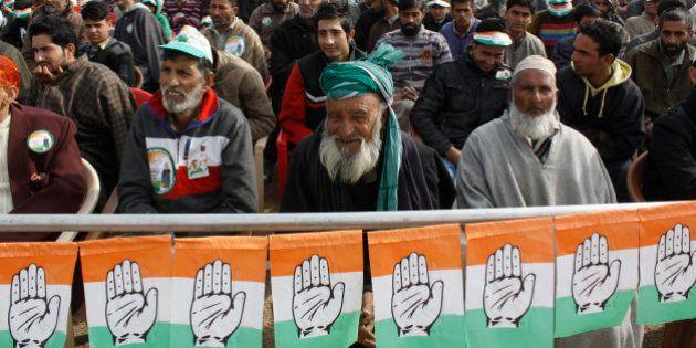 SRINAGAR, INDIA - NOVEMBER 21: Congress supporters listen to the speech by party president Sonia Gandhi...