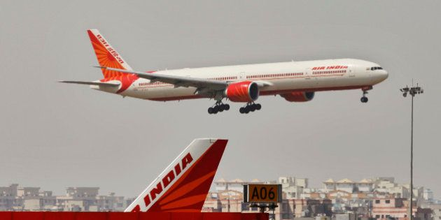 An Air India plane flies in New Delhi, India, Thursday, April 12, 2012. The Indian government approved...