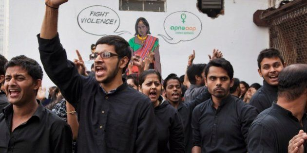Students perform a street play to create awareness on violence against women during a protest ahead of...