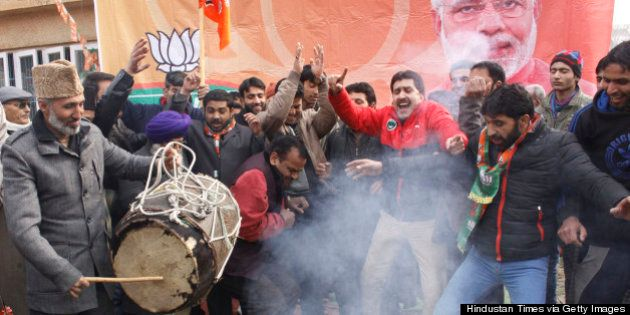 SRINAGAR, INDIA - DECEMBER 24: Bharatiya Janata Party supporters dance to celebrate their victory in...