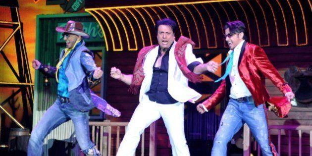 Indian Bollywood film actors Ranveer Singh, (L), Govinda (C) and Ali Zafar perform during the promotion...