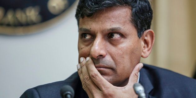 Raghuram Rajan, governor of the Reserve Bank of India (RBI), attends a news conference at the central...