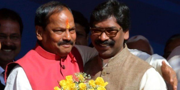 Newly elected Chief Minister of the eastern Indian state of Jharkhand Raghubar Das (L) is congratulated...